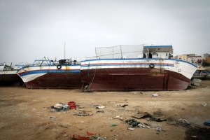 Abandoned-migrant-boats-lie-lifeless-opposite-the-port-of-Lampedusa-Italy-an-island-which-experiences-frequent-migration-from-nearby-North-Africa.-300x200