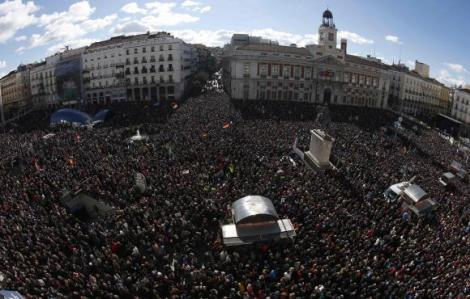 People fill Madrid's landmark Puerta del Sol as they gather at a rally called by Spain's anti-austerity party Podemos (We Can)